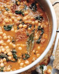 Chickpea Stew with Spinach and Chorizo. This stew, like all those in Catalonia, starts with a sofrito, a thick sauce made with sautéed onions and tomatoes. Once you get all the ingredients in the pot, there's not much to do besides enjoy the aroma wafting from this hearty, spicy, soupy stew as it slowly cooks.