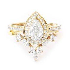 Unique pear diamond bridal rings set. This link is for the rings set. Main stones can be: sapphire, diamond, moissanite, morganite, opal, moonstone, turquoise, ruby, black diamond, peach sapphire.... Our diamonds are all natural with absolutely not enhanced or treatments. I use
