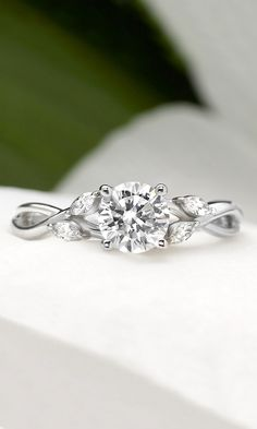 wispy vines of precious metal entwine toward lustrous marquise diamond buds in this nature-inspired trellis ring
