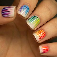 We are in love with these rainbow waterfall nails from The Nailasaurus. Click to learn how to get this beautiful design.