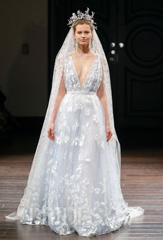 "Brides.com: Naeem Khan - Spring 2016                          ""Positano"" sleeveless French blue tulle A-line wedding dress with a plunging V-neck and hand painted veil, Naeem Khan                                                                                  Photo: Luca Tombolini / Indigitalimages.com"