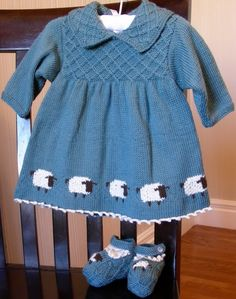 Sheep Dress by Debbie Bliss, found in the book called The Baby Knits Book. It happens to be out of print but is still available at Amazon.
