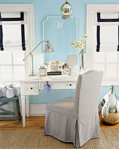 The bold look of the roman shades from pottery barn. Classic, but bold. Love the desk, lamp and clocks too!