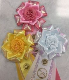 View our collection of ribbons and rosettes available in accents including floral, patterned, glittery golds, silvers and more. Ribbon Rosettes, Centaur, Garter, Photo Galleries, Floral, Ideas, Design, Blue Prints, Flowers