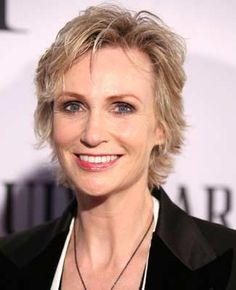 """""""I lead the game by asking the questions and telling what the rules are - and enforcing them,"""" says """"Hollywood Game Night"""" host Jane Lynch. """"I'm a cheerleader and a shamer at the same time."""""""