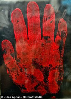 A red hand print made by John Wayne Gacy, the American serial killer known as the Killer Clown, on display at the Murderabilia exhibit in England. Click for more items in the museum.