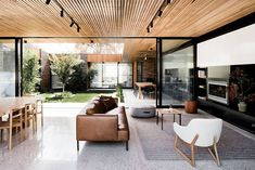 A wood-clad ceiling with seamless continuation between the courtyard and indoor…