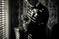 I love this shot of the groom getting ready. #weddingphotography