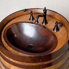 Sink made from old wooden barrel.. Cute Idea for Bar or on deck by BBQ Grill