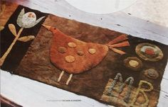 Henny Penny wool table runner by Maggie Bonanomi.  From American Patchwork & Quilting; Dec 2011 issue