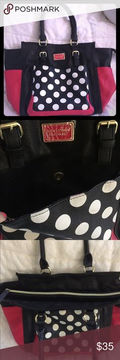 Betsy Johnson Polka Dot purse Red, black, and white polka dot purse from Betsey Johnson. Zip closure! Pockets!!!!! 1 pocket in front for keys. 2 side pockets that fit water bottles. Perfect purse for a mom or a fit chick  (there are always two bottles in my purse and this one has specific spots for them). Pen mark on back of purse,was there when I purchased it. It's on the back (not a bid deal right?) that was my thought.. Betsey Johnson Bags