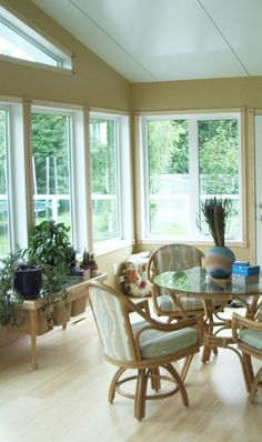 This four season sunroom opens up on to a second story deck. Four Season Sunroom, Second Story Deck, Floor Insulation, Wedding Table Numbers, Bedroom Inspo, Open Up, Living Spaces, Windows, Sunrooms