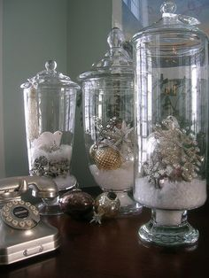 "Christmas decor: hurricane vase with lid, ""snow"" and ornaments."