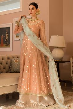 indian designer wear A salmon pink badla botti anarkali with gotta and zardozi embroidery on the sleeves and neckline. It comes with a lam'e gharara and organza dupatta with block Pakistani Fancy Dresses, Beautiful Pakistani Dresses, Desi Wedding Dresses, Pakistani Wedding Outfits, Pakistani Bridal Dresses, Pakistani Dress Design, Indian Dresses, Indian Outfits, Pakistani Frocks