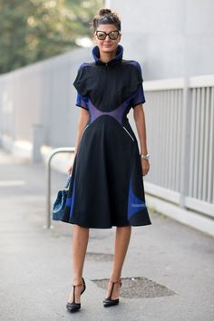Milan Fashion Week spring 2014, Street style. Giovanna Battaglia in beautiful black constructed dress with interesting details in blue and lilac, heels with t-strap.