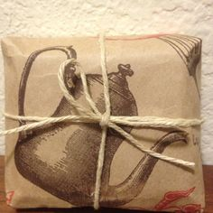 My cutest up-cycled wrapping yet! A Trader Joe's bag and some twine.