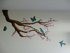 Made some new wallart in a babyroom #wallart #wallpainting #amateur #painter #painting #babyroom #babygirl #artist #art #blossom #tree #butterfly #birdy
