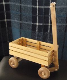 Children's Eco Friendly Toy Wooden Wagon with Wheels for Kids Organic Natural Unpainted Preschool Montessori. $29.99, via Etsy.