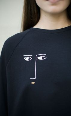 Abstract face print sweater; embroidery inspiration; sewing; creative fashion design detail // Kowtow