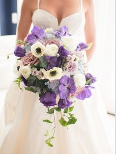 Purple #wedding #bouquet idea - overflowing wedding bouquet with purple flowers and anemones {Raining Roses Productions, Inc.}