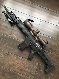 r/GunPorn - New scope for my scary black rifle.