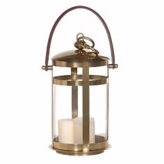 Aged Brass & Glass Lantern With Leather Handle - Medium: An aged brass frame with a stitched leather handle around a plain glass cylinder. A classic design. Use on its own, as a pair, or with it's larger companion to create the perfect welcoming atmosphere.