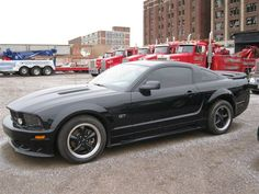 2005 Ford Mustang GT but mine was GORGEOUS red with red on black interior