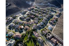 """How The 1% Lives—A Haunting Photo Series #refinery29  http://www.refinery29.com/1-percent-photo-series#slide-7  A cluster of gated homes and an oasis of green lays in the desert of Henderson, Nevada. """"What I love about this image is the adjacency of the really grim, drought-stricken land around these homes, [which are] the lush oasis in the community,"""" Little says. ..."""