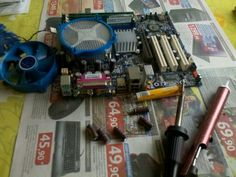 DIY: Soldering some capacitors to make this mobo work.