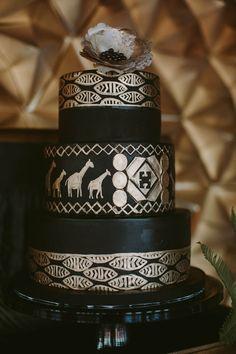 black and gold wedding cake - photo by Megan Saul Photography http://ruffledblog.com/modern-safari-wedding-inspiration #weddingcake #cakes