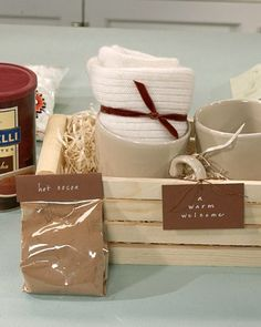 Collect just the right ingredients for to warm guests. Start with a large container of hot cocoa and a bag of mini marshmallows, measuring them out into individual serving sizes and placing them in small cellophane bags. You can also include two mugs, each filled with a pair of new, cozy socks.