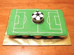 Pull apart cake with Individual cupcake as soccer ball. Put plastic goals on each end