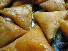 Almond Briouats  These popular Moroccan cookies are made by folding almond paste flavored with orange flower water and cinnamon within warqa dough. The pastries are fried and then soaked briefly in honey. Almond Briouats are commonly served at both special occasions and casual tea times.