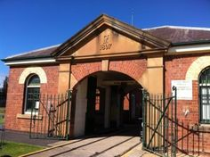 NEWINGTON ARMORY in Sydney Olympic Park was formerly the Royal Australian Naval Armament Depot  which was used to store volatile ammunition including depth charges, torpedoes and explosive shells. It has over 100 heritage buildings set amidst the 52 hectare landscape.