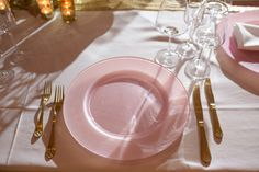 Blush Pink Glass Charger Plate and Gold Cutlery  http://www.qubeevents.co.uk/hire/tableware/cutlery/gold-cutlery-set.html