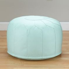 Now, here's a clever little seat that's modeled after traditional Moroccan poufs.  It can double as a comfy play chair and an ottoman.  Your kids are going to love it.  Go ahead, try it out for yourself.  You'll notice it's sturdy, yet comfortable, thanks to the dense polystyrene beads and faux leather cover (a blend of cotton, PVC and polyurethane).