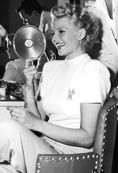 Rita Hayworth on the set of The Lady From Shanghai (1947) with husband Orson Welles (look in the mirror).