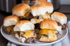 Roast Beef Sliders (slow cooker)Beef and beer come together to make this perfect game day grub.