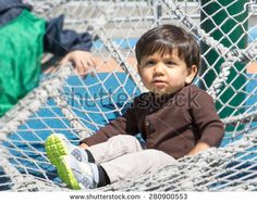 Young male toddler expends energy during playtime