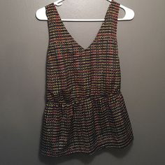 Patterned Peplum tank with cutout detail in back Patterned peplum tank with cutout on the back of the shirt. 100% polyester and super flattering on many body types! Forever 21 Tops Blouses