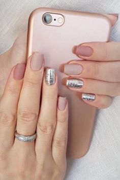 Nail Design with Nude nail polish colors and silver glitter accent. #Nails #NudeColors #Glitter