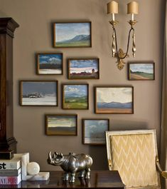 Kristen Buckingham Interior Design: Striking, brown/clay wall color! Pretty collection of landscape paintings in simple ...