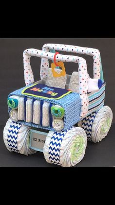 Looking for a unique baby gift NO ONE else will be giving?? This diaper jeep is PERFECT for your next baby shower gift! Whether youre looking for a mom to be gift, or an awesome diaper centerpiece, this diaper cake is sure to be a crowd pleaser!! ****Each diaper cake is uniquely made. Variations may need to be made based on product availability. Please message me with color schemes and or themes that I need to work with.**** This Diaper jeep is FULLY LOADED with: -85 size 1 Luvs diapers -8…
