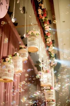 Bubbles (using machine) Amidst hanging crystals & birdcages with florals!! How whimsical!!!