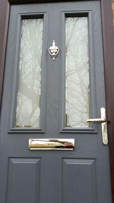 Slate grey door with Rosewood effect frame. Www.xtremedoor.co.uk composite door