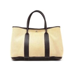 Hermes dark brown leather garden party tote  comes with original dustbag  measures 14 X 10 X 6.5 inches  minor wear to corners  asking $790  comment for more information or to purchase this item