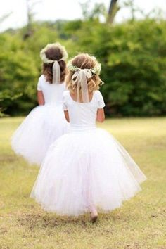 little flower girls with white tulle ballerina skirts and floral crowns