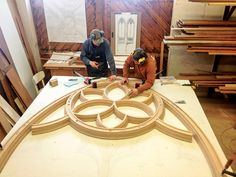 The main arch tracery underway in the shop. Note the scale of the woodwork compared to the craftsmen, and how the circular rose will be supported by the lancet arches to come. Creative Inventions, Gothic Furniture, Wood Joints, Curved Wood, Church Windows, Wood Architecture, Woodworking Wood, Architectural Elements, Wood Turning