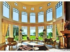Perfect room for a piano in the middle and bookcases 2 stories tall on the walls without windows:)