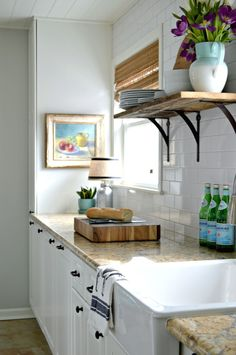 Updating a small dark kitchen and turning it into a bright white space with tons of storage.